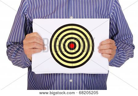 man is holding sheet of paper with a target drawn on it poster