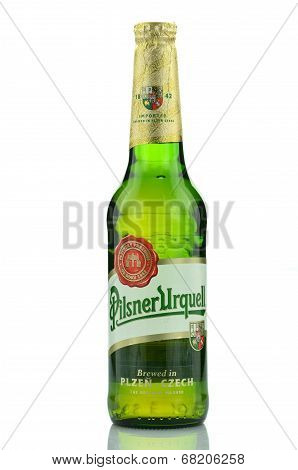 Pilsner Urquell pale lager beer isolated on white background