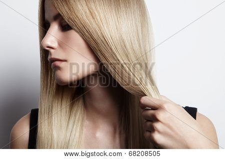 Blondy Woman Holding Her Hair