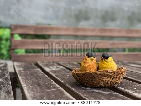 The couple of ceramic birds for decoration in the garden poster