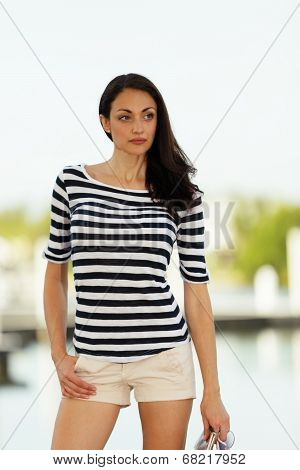 Attractive woman posing a striped shirt