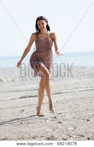 Model running on the beach stock image