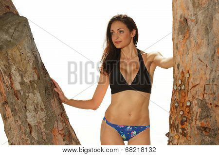 Bikini model posing in a nature setting