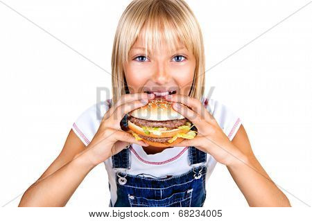 Girl eating Hamburger. Child with hamburger. Pretty little girl eating a sandwich isolated on white background