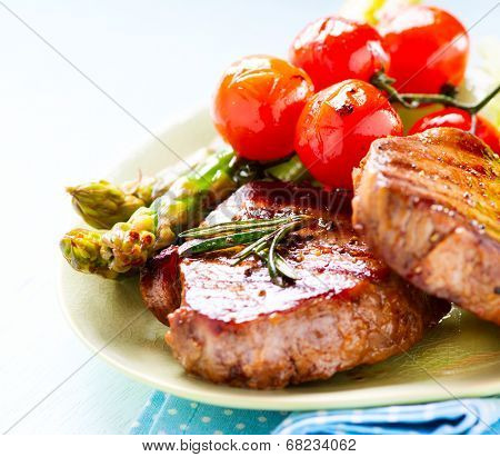 Grilled Beef Steak Meat with Asparagus and Cherry Tomato. Steak Dinner. Food. BBQ Grill. Berbeque. Barbecue poster