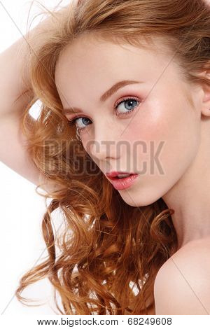 Young beautiful red-haired woman with fresh clean make-up over white background