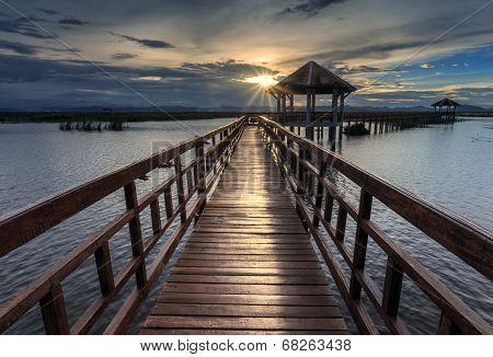 The Long Wooden Bridge During Sunset