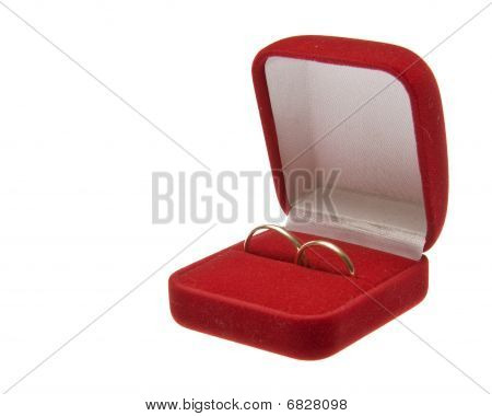 Two Golden Wedding Rings In Open Red Box Isolated On White Background