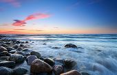 Sunset over the Baltic sea. The pebbly beach in Rozewie poster