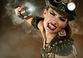 Portrait of a beautiful steampunk woman over smoke background.  poster