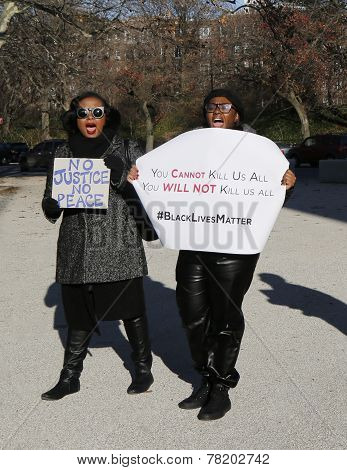 Protesters march against police brutality and grand jury decision on Eric Garner case