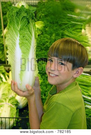 Boy Holding up Produce