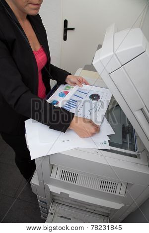 business woman making copies on the photocopy machine at the office