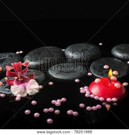 Spa Still Life Of Zen Stones With Drops, Orchid Cambria Flower And Pearl Beads, Red Candle On Water,