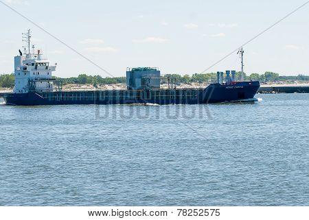 Transport ship goes via Baltic sea channel to sea