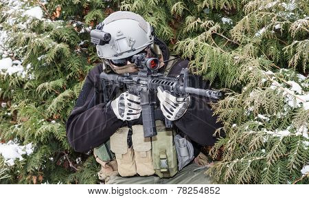 Private military contractor PMC with assault rifle in the winter forest poster