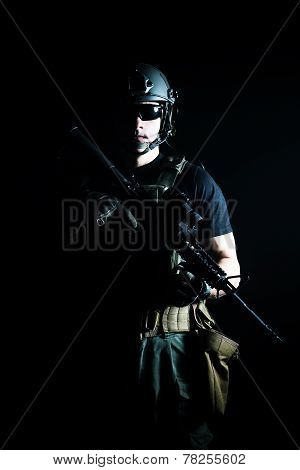 Private military contractor PMC with assault rifle on dark background poster