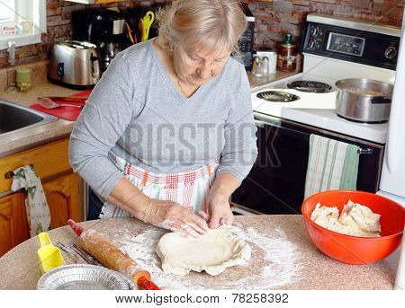 Grandmother Making Pies