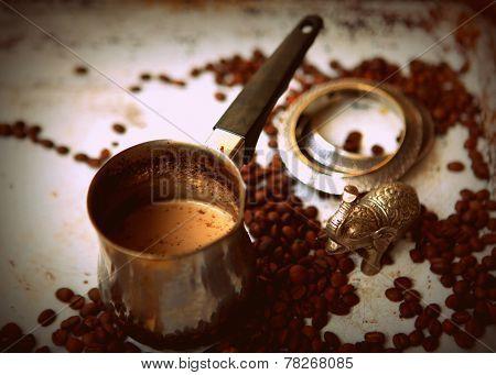 Coffee, bracelets and metal statuette