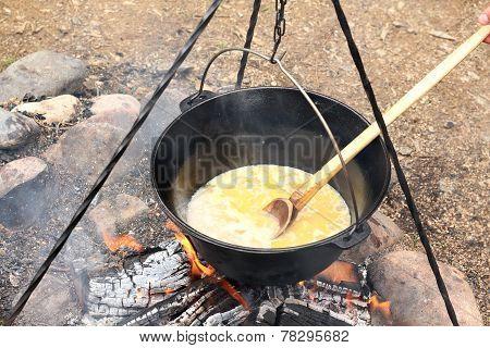 Black Cauldron On Camping Fire