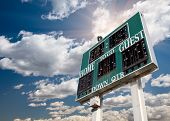HIgh School Score Board on a Dramatic Blue Sky with Clouds and Sun Rays. poster
