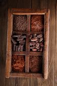 old spicy box full of chocolate - cocoa and sugar, cocoa beans, grated chocolate, hot chocolate flakes, solid pieces, dark cocoa powder poster