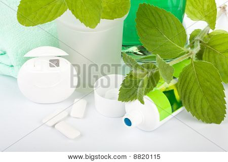 Toothbrush With Toothpaste And Fresh Leaves Of Mint