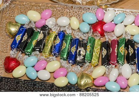 Round colored candies on a festive table