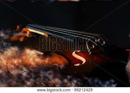 Elegant violin with smoke on black background - selective focus