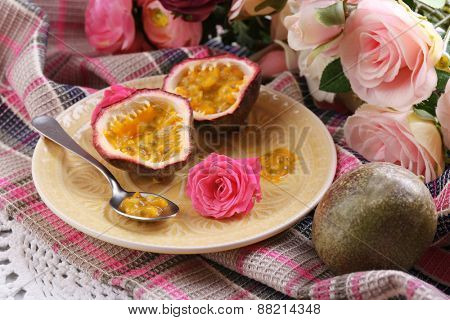 Passion fruit on plate on color napkin background poster