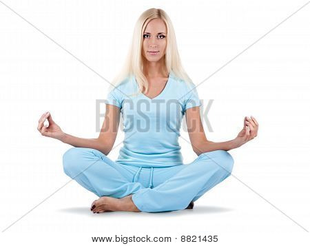 Woman Is Sitting In The Lotos Position