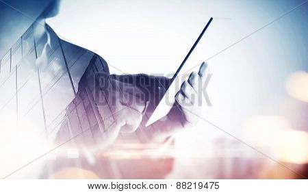Double Exposure Of City And Hands Using Tablet. With Special Lighting Effects