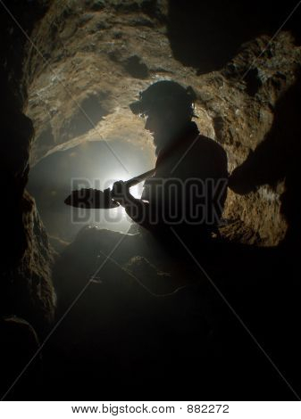 Silhouette Of Cave Digger