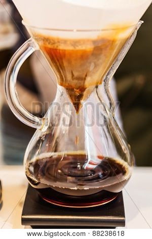 Making brewed coffee from steaming filter drip style poster