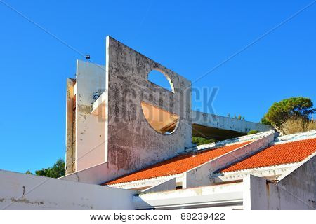 Abandoned and damaged modern buildings against blue sky poster