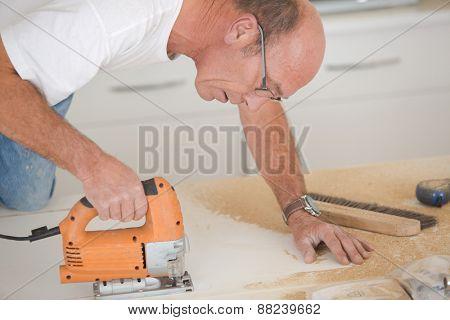 Man using a band saw