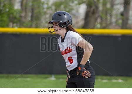 Female Fastpitch Softball Player Watching For Coaches Signals