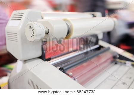 The image of a laminating machine