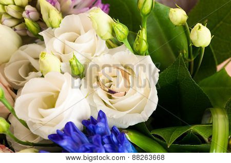 beautiful wedding ring in a wedding bouquet of flowers
