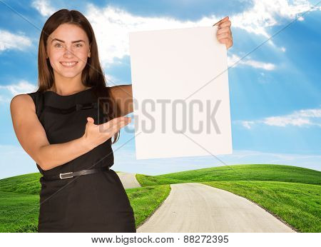 Young woman holding blank poster with nature on background