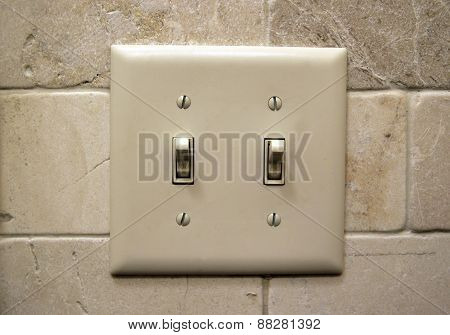 Light switch on a wall in a home.