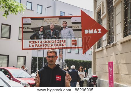 Guy Holding Dmax Sign At Fuorisalone During Milan Design Week 2015