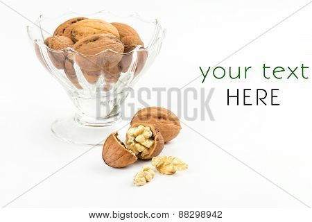 open walnuts dish closeup on white background poster