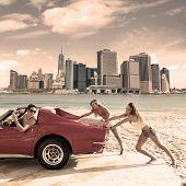 Car pushing teen girls humor funny guy driving in Manhattan New York photo mount poster
