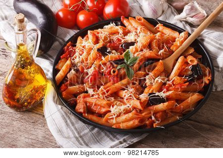 Penne With Eggplant And Tomatoes Closeup And Ingredients. Horizontal