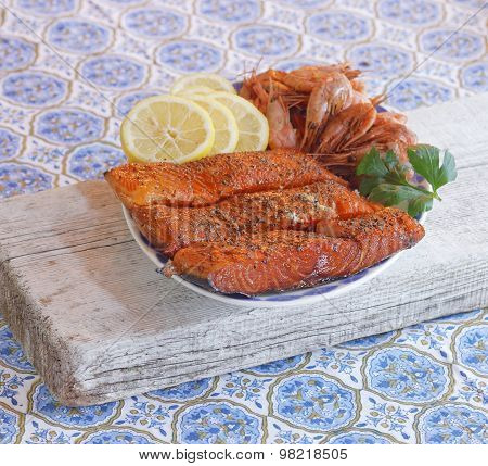 Plate Of Smoked Salmon, Shrimps, Lemon And Parsely