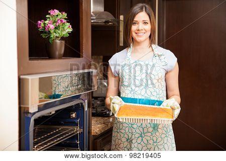 Cute Woman Baking A Cake At Home