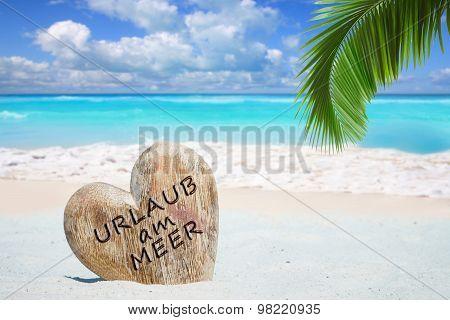 Wooden Heart On The Beach