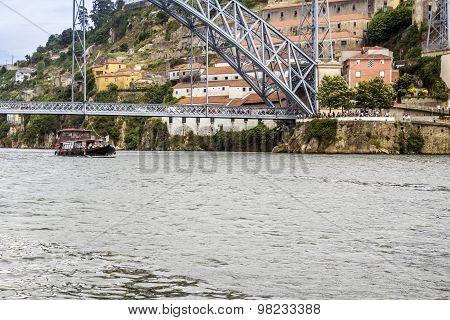 Panoramic from Douro river tour boat view of Dom Luiz Bridge and Gaia riverbank Porto cityscape Portugal. poster