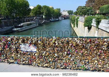 PARIS, FRANCE - SEPTEMBER 8, 2014: Paris - Pont de l'Archeveche (Archbishop's Bridge) covered with love padlocks. The Pont de l'Archeveche is the narrowest road bridge in Paris